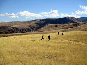 Small group of people walking in open rangeland
